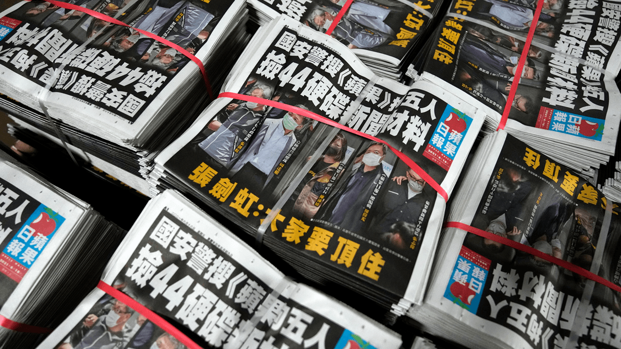 Massive raid on Hong Kong newspaper Apple Daily sees editor-in-chief and four others arrested