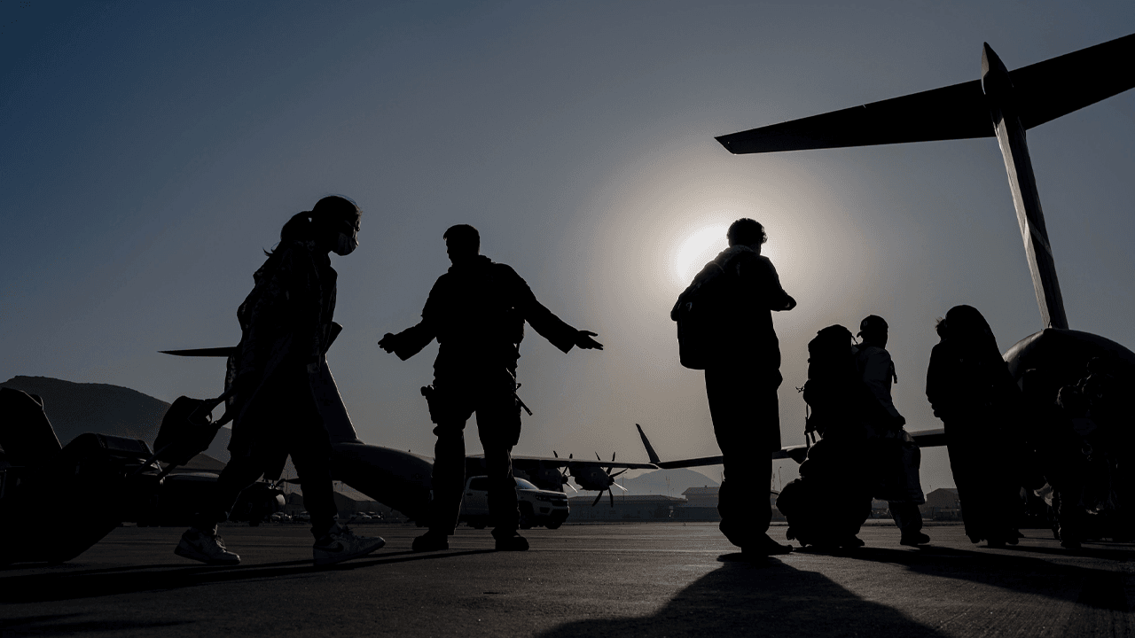 "Two U.S. congressmen, both veterans, make secret trip to Afghanistan to ""provide oversight"" on evacuation"