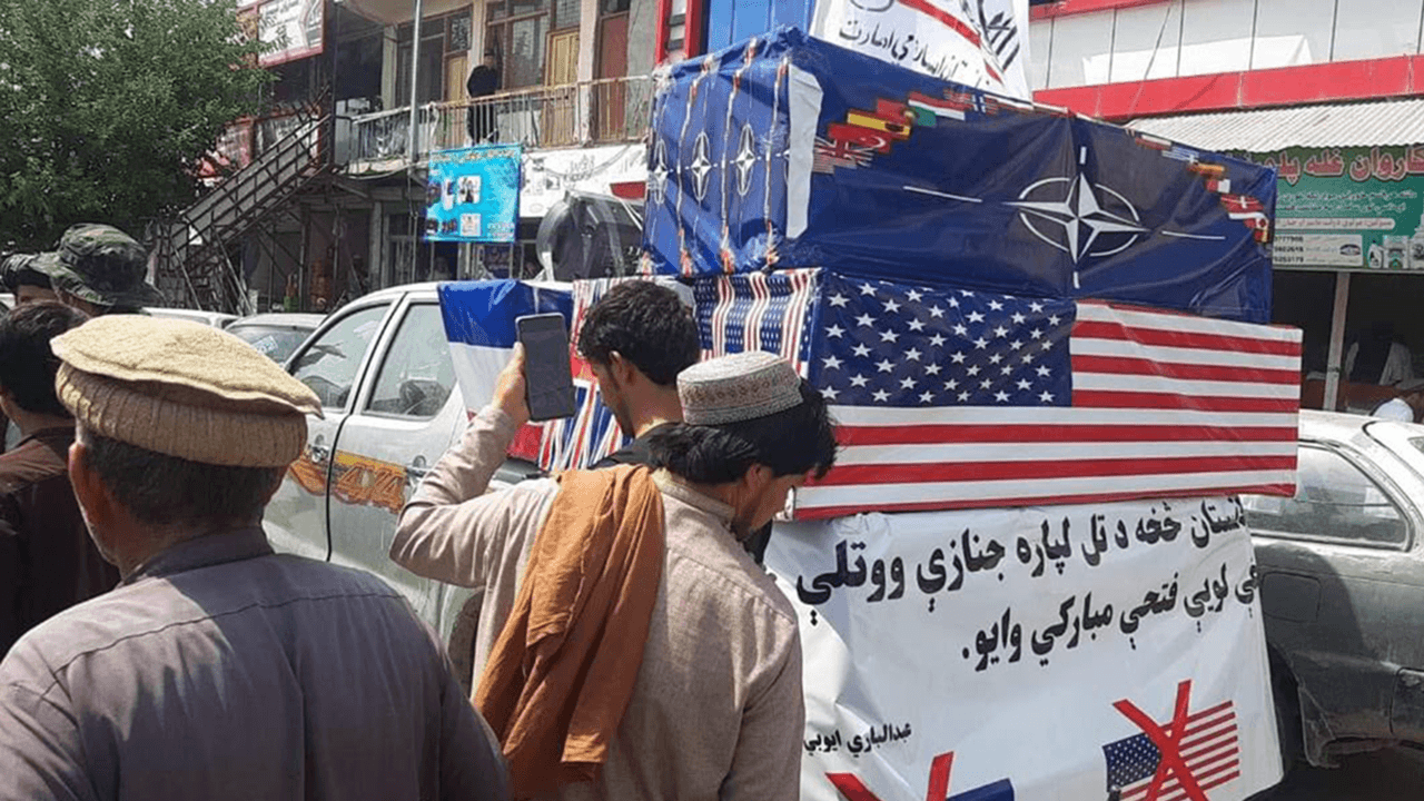 Taliban hold mock funeral to celebrate Afghanistan victory with coffins draped in American, NATO flags