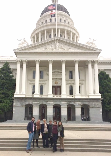Members of the Policy Brigade along with Sustainable Economies Law Center Staff in front of the State Capitol.