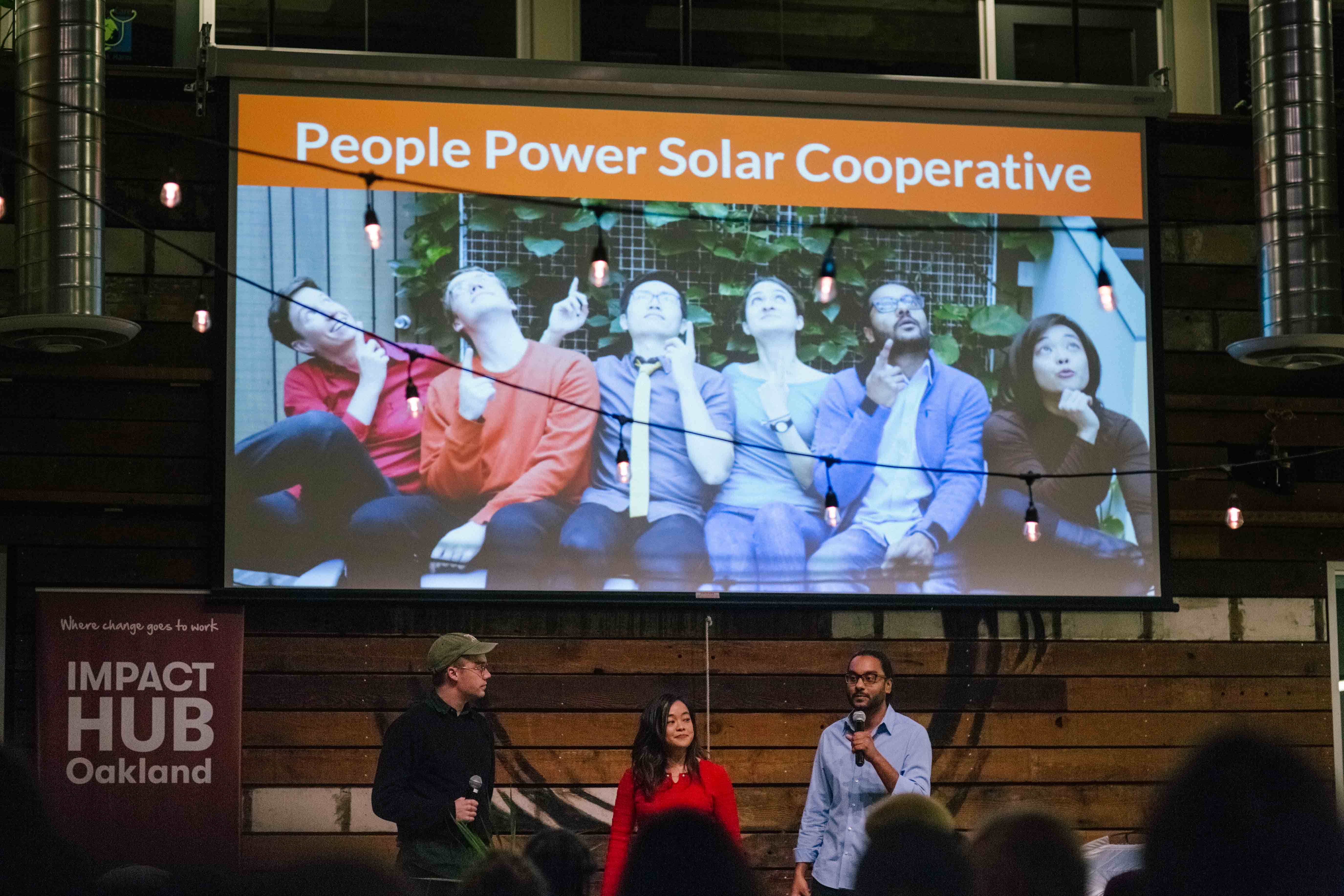 Member of People Power Solar (L-R: Grayson Curtis, Crystal Huang, Subin Devar) addressing the crowd.