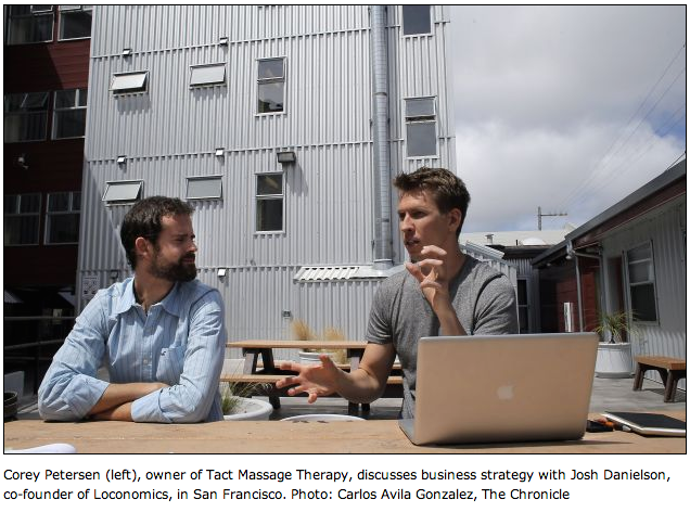 Corey Petersen (left), owner of Tact Massage Therapy, discusses business strategy with Josh Danielson, co-founder of Loconomics, in San Francisco. Photo: Carlos Avila Gonzalez, The Chronicle