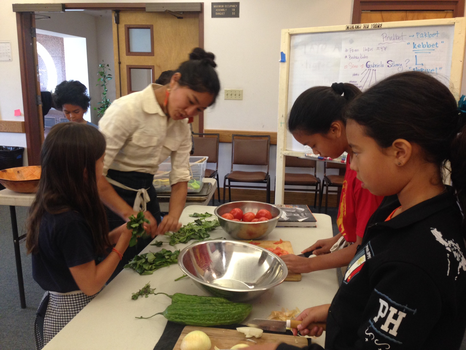 Instructor Aileen Suzara teaches Sama Sama camp-goers how to make pinakbet.