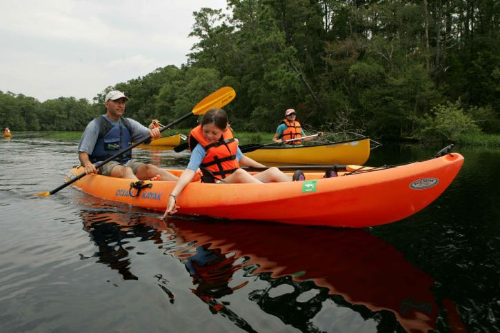 young-child-enjoys-the-water-during-a-kayak-trip-725x483.jpg