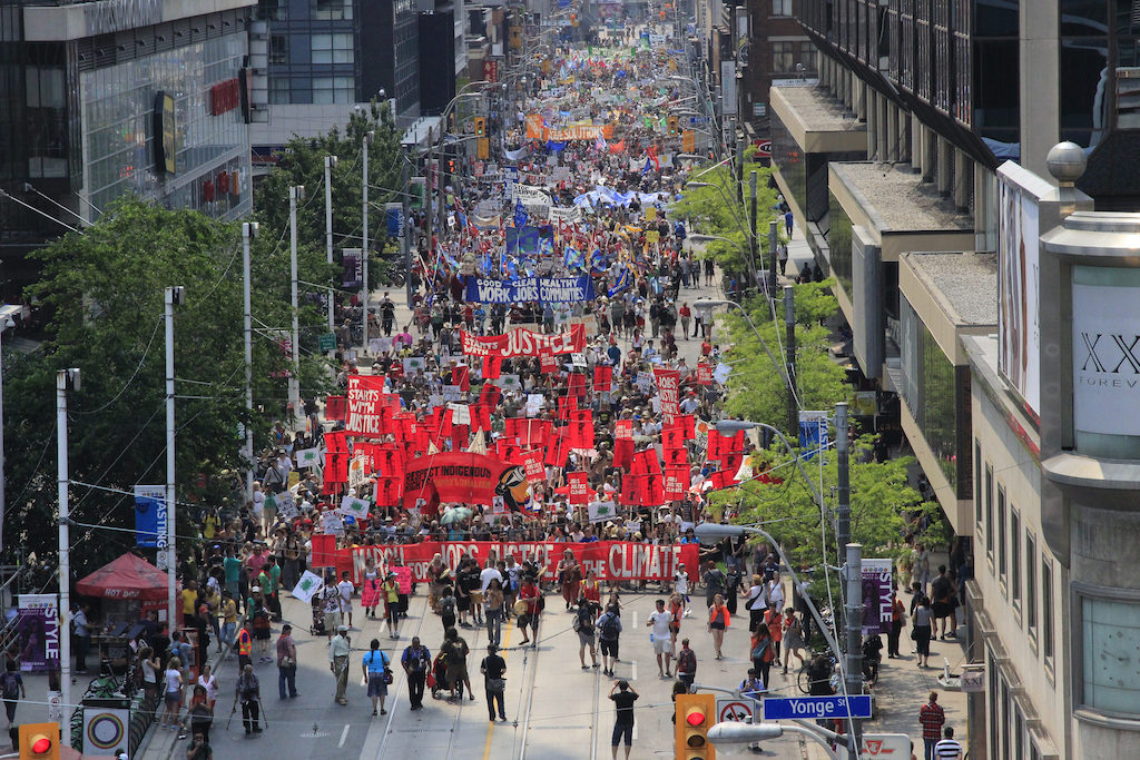 Aerial image of the march with thousands of people and bright signs