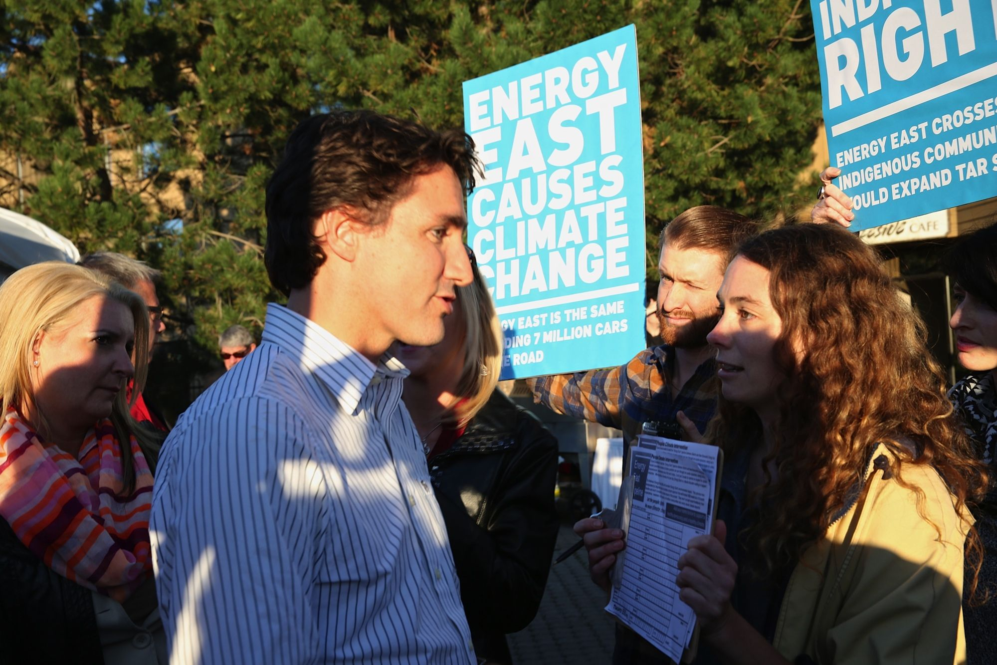 To350 member, Katie Krelove asks Trudeau to sign a petition for climate impacts to be part of NEB's assessment of the Energy East pipeline