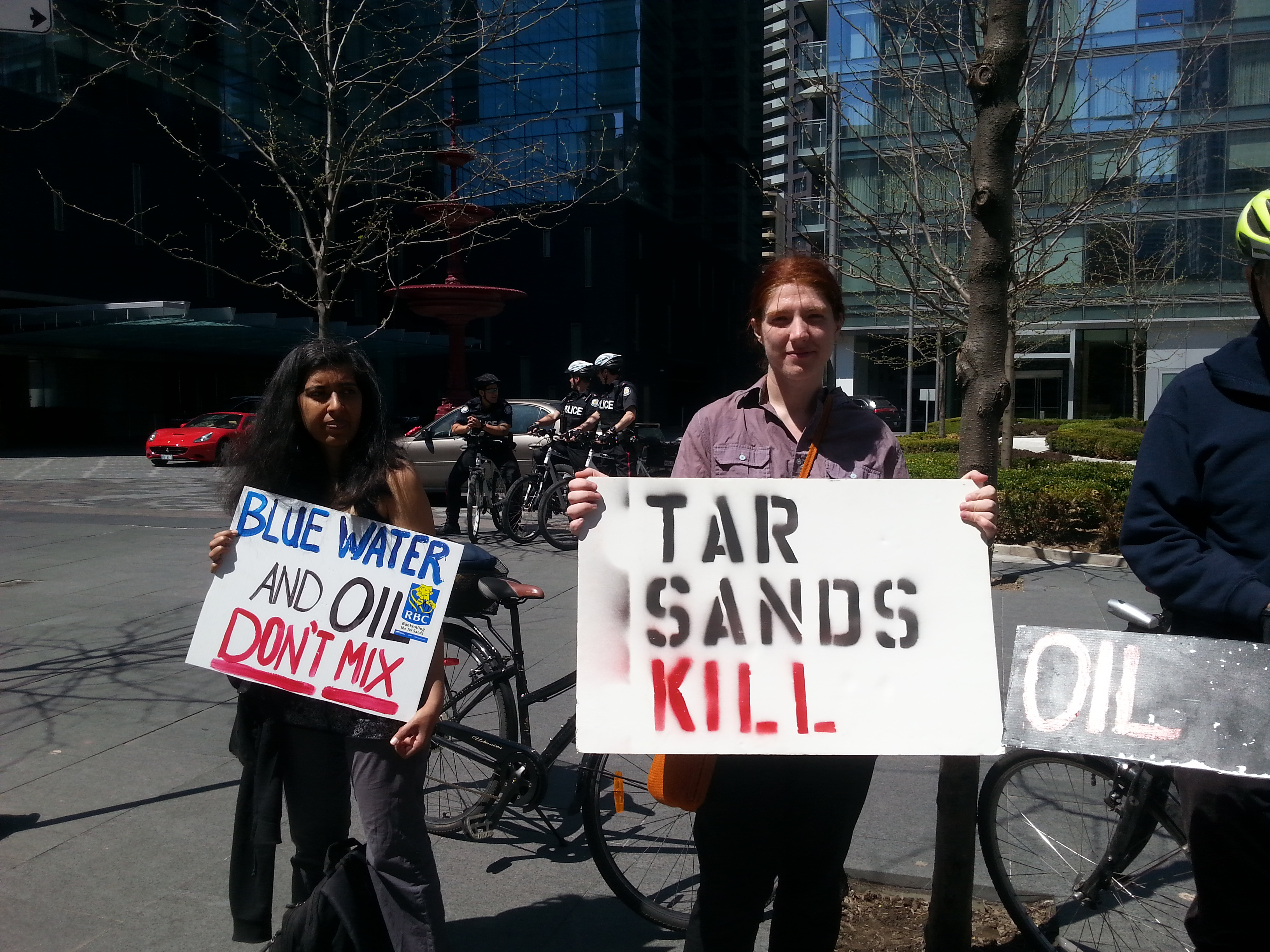 Protesters hold anti tar sands banners