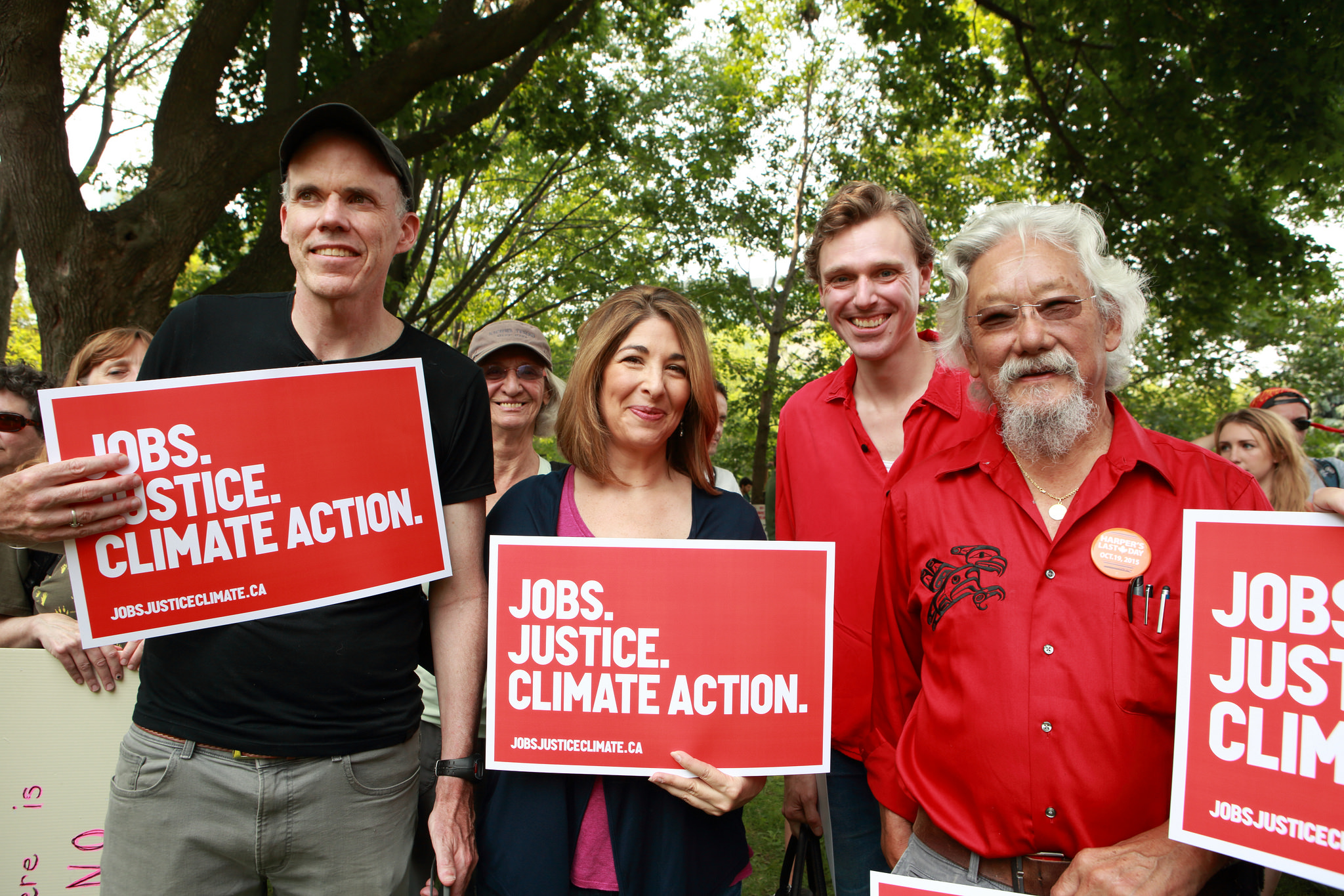 Bill McKibben, Naomi Klein, Joel Plaskett and David Suzuki hold signs for the march
