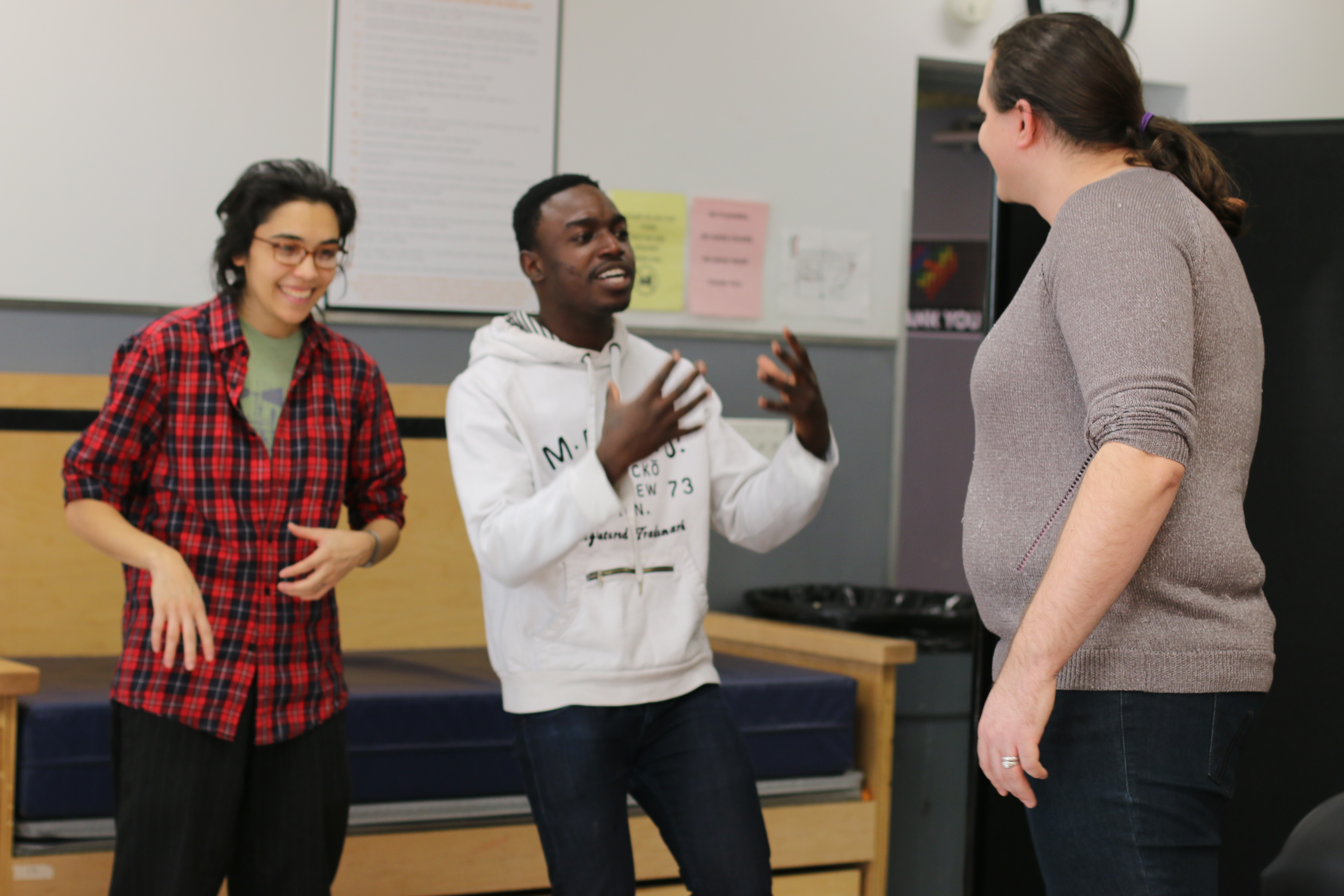 Three actors rehearse a scene for the new forum play Trap