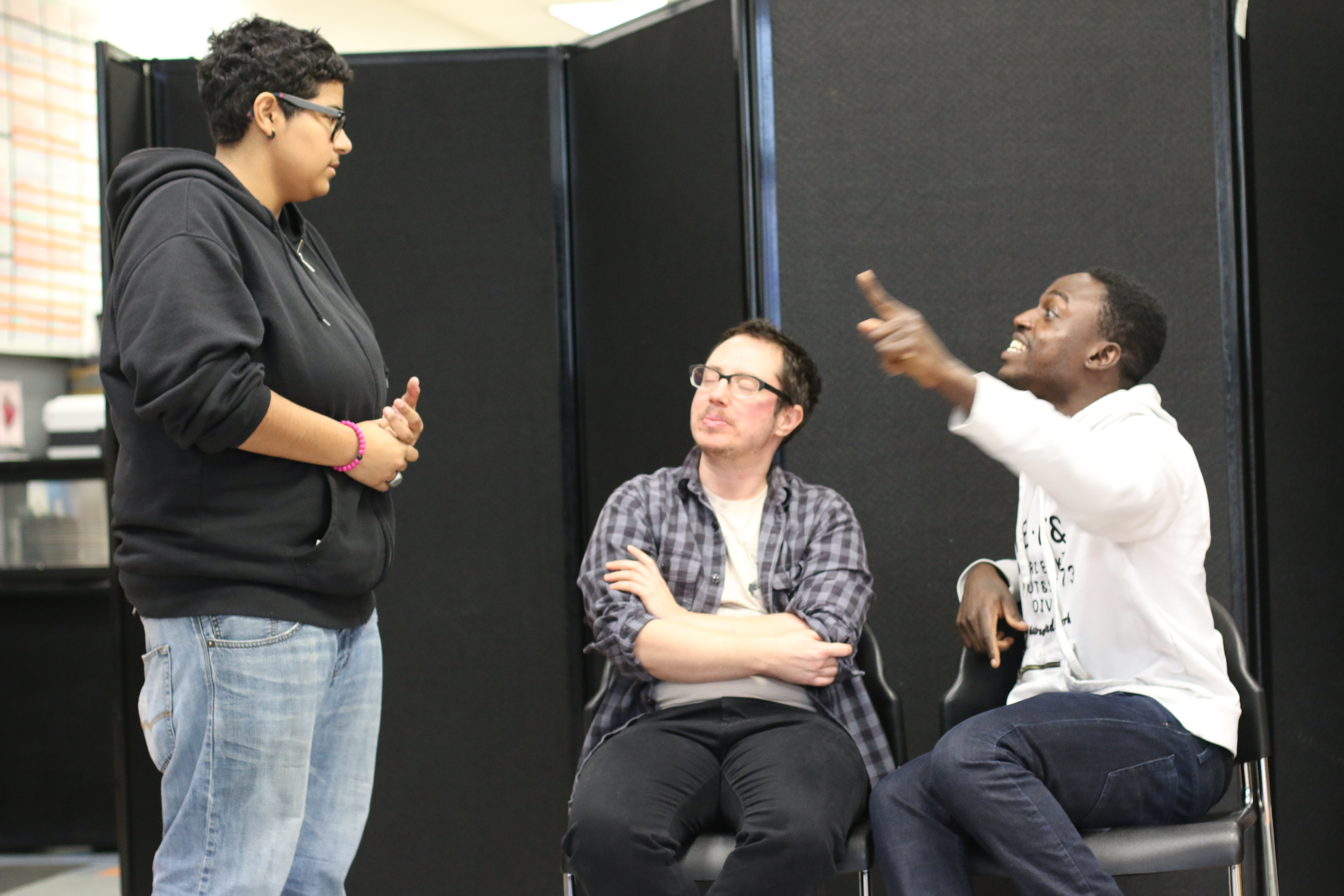 Three actors rehearse a scene that takes place on a train for Trap, a new forum play