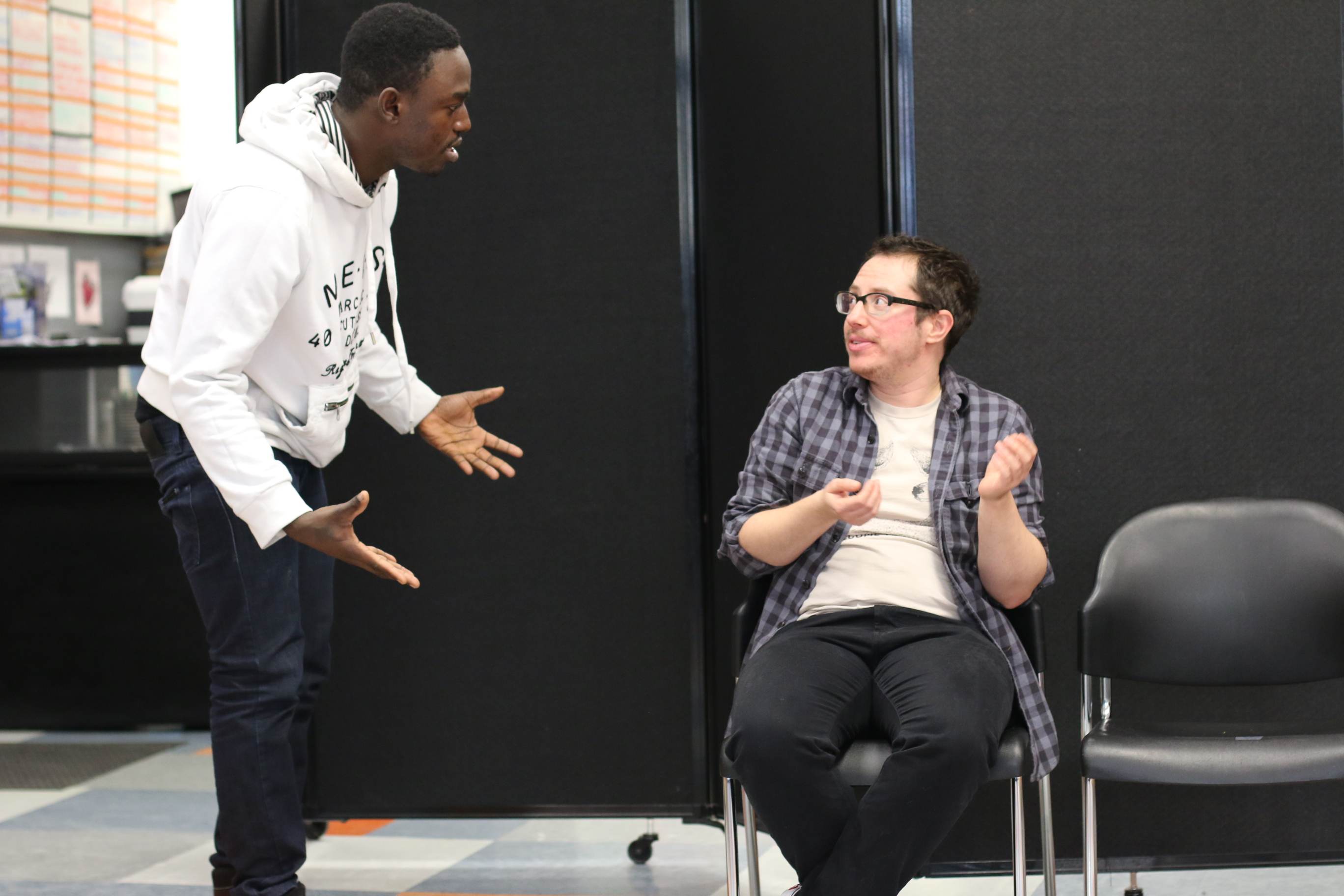 Two actors rehearse a scene from Trap