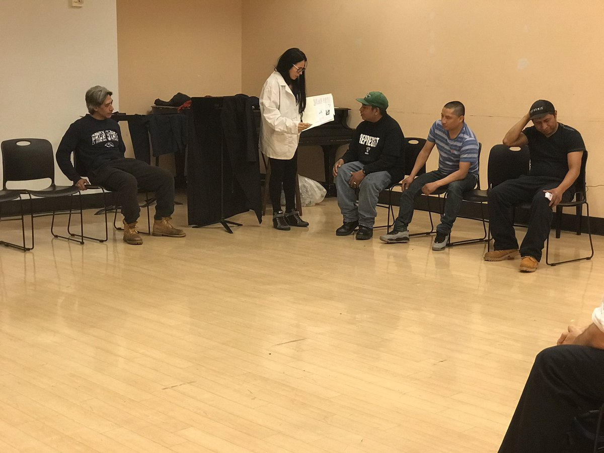Five actors perform a scene