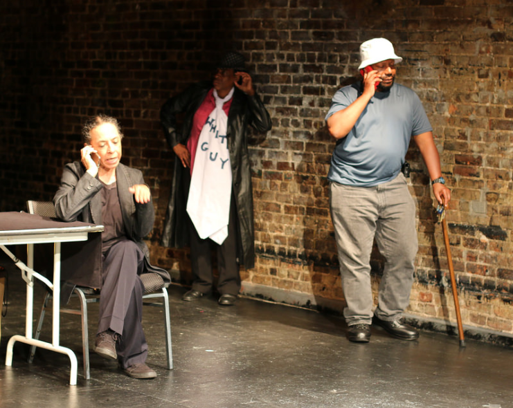 Three actors perform a scene