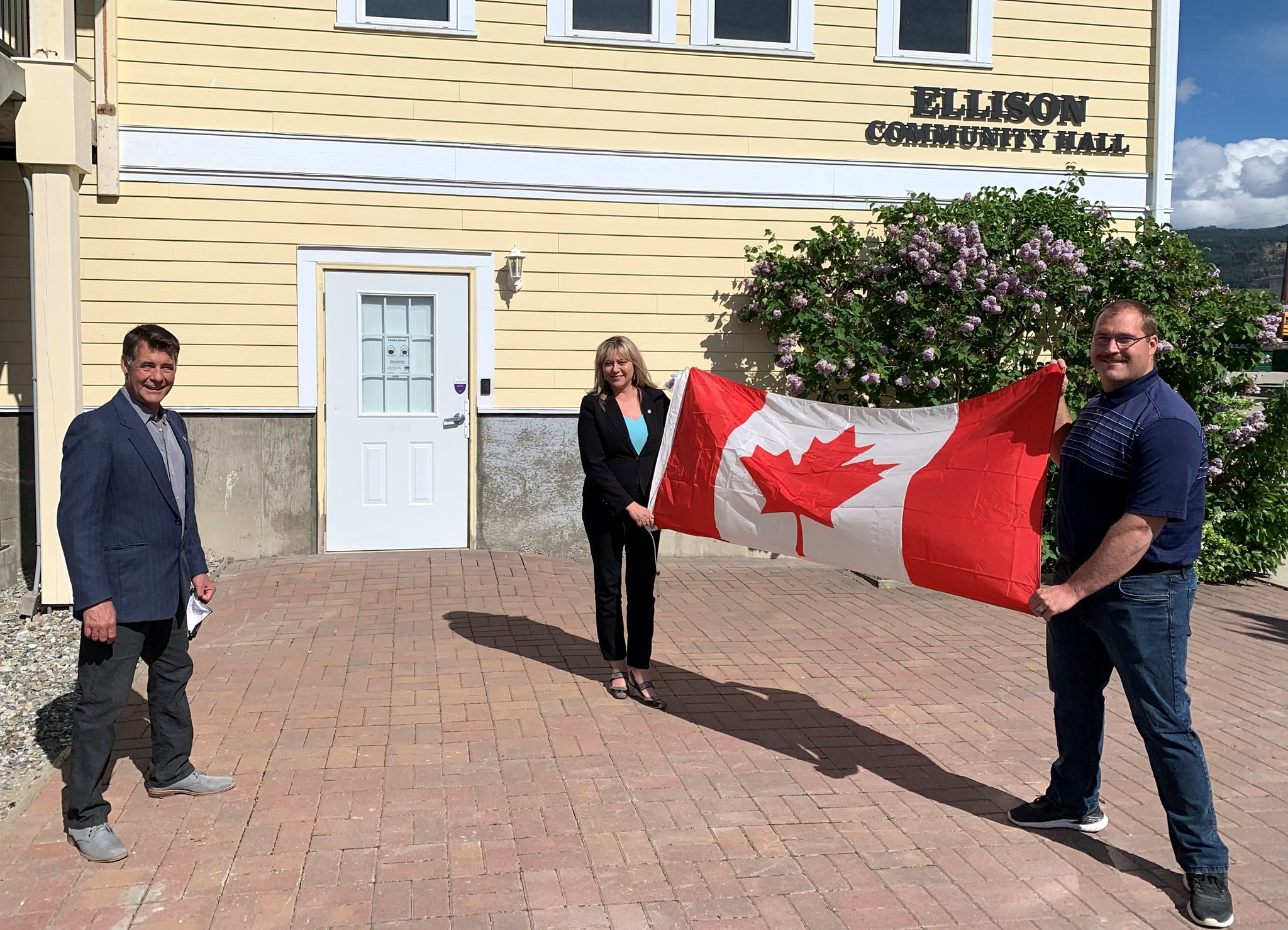 Delivering a Canada Flag to the Ellison Community Hall