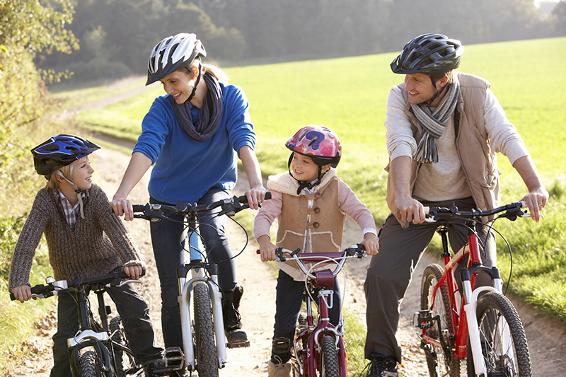 bigstock-Young-family-pose-with-bikes--13920725.jpg