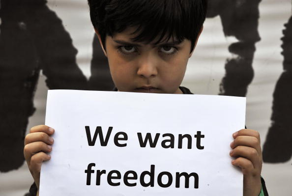 Iranian_Child_Holding_Placard.jpg
