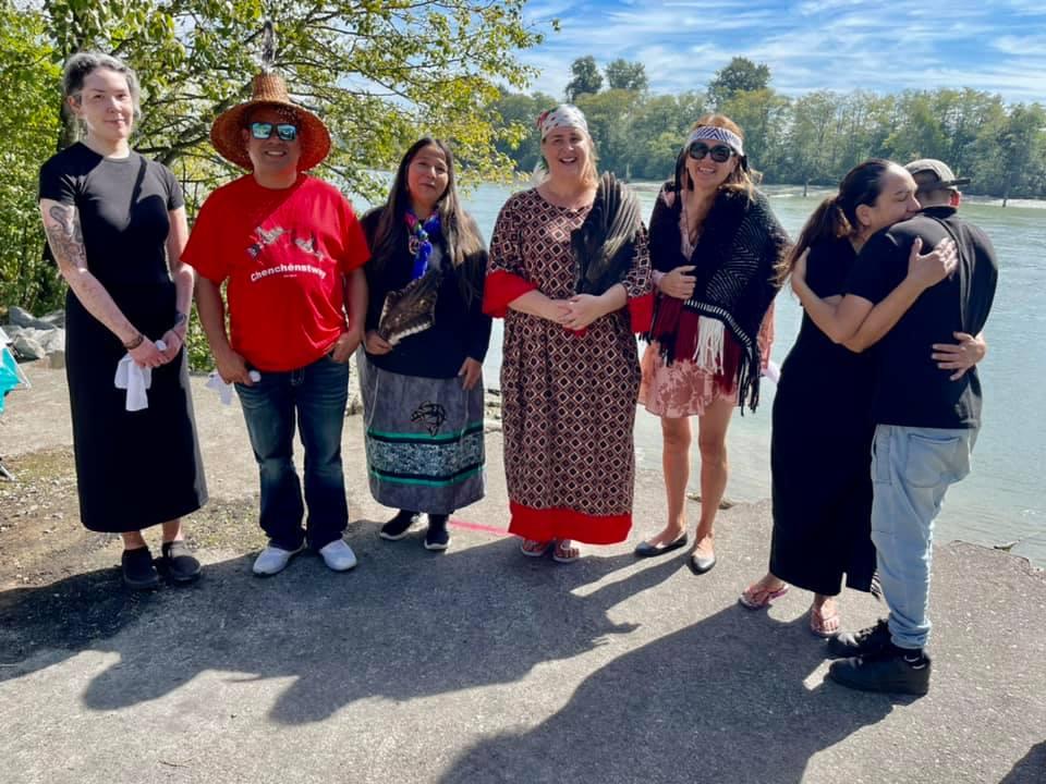 Left to right:  Pinensikwe Cheyenne Baker (Squamish-Kwakwaka'wakw), John Spence (Squamish), Kukpi7 Judy Wilson (Secwepemc), Sara Brooke Cadeau (Anishnaabekwe), K'ana Deborah Baker (Squamish), Wendy Kwekwáyel Simia Wendy Nahanee, & Keona Nahanee.