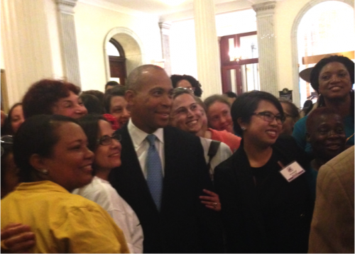 Governor Deval Patrick poses with domestic worker activists, including MataHari director and UFE board member Monique Nguyen Belizario (right front, with nametag)
