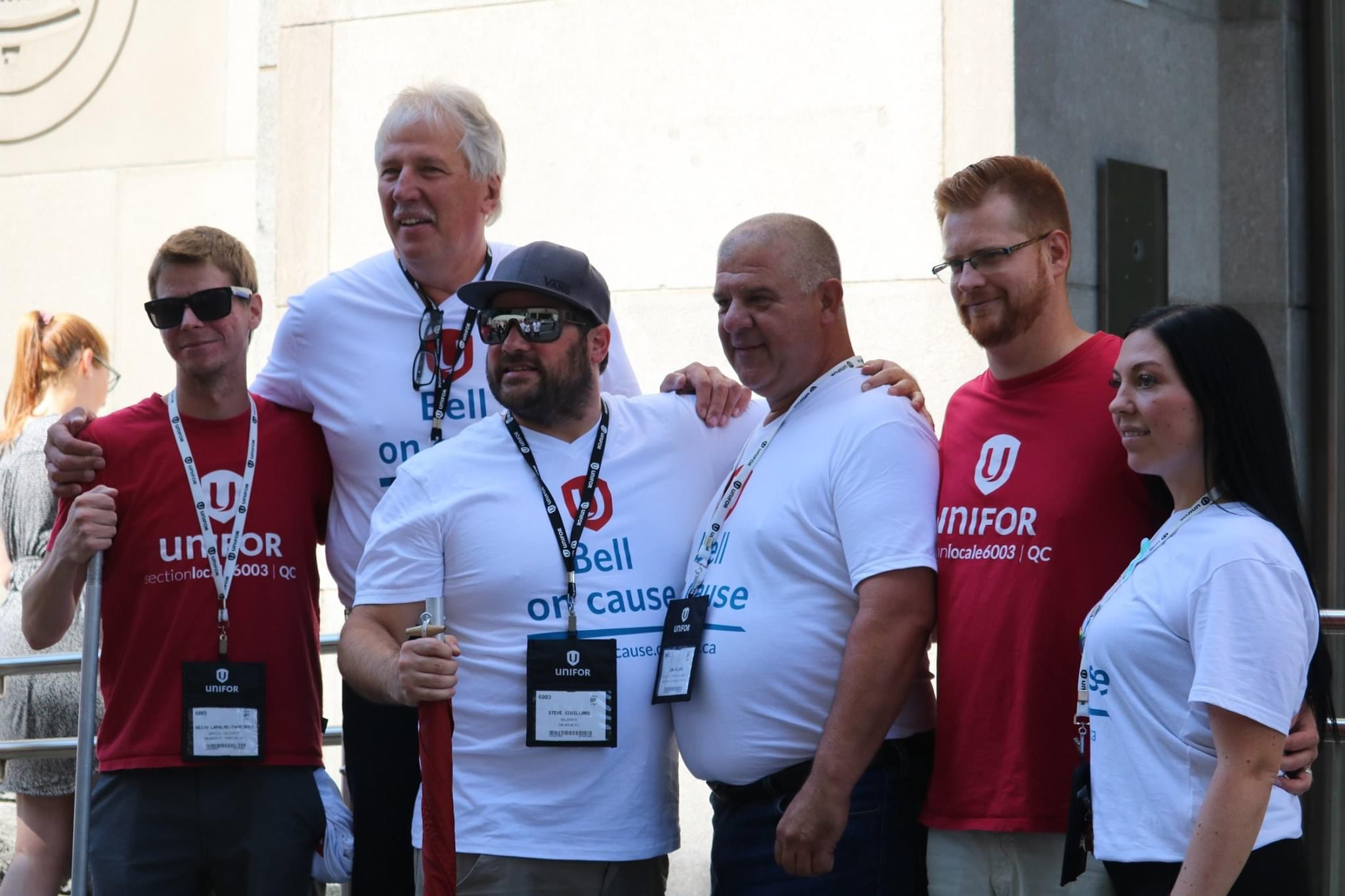 Renaud Gagne poses with 5 telco members at a rally in Quebec City.