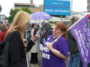 Liverpool Acute Branch Sec Su Edwards fields media queries at the pay rally outside the Royal.