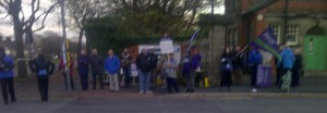 Early morning pickets in Sefton, with a busker providing entertainment.