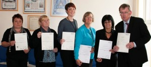 Pictured with their certificates are (from left) Sarah Howell, Louise Wilson, Sarah Tattersall, Jean Foster, Kim Griffiths, and Unison's Roger Pakeman.