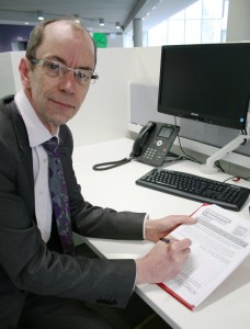 Leader of Rochdale Council, Cllr Colin Lambert, signing the petition.