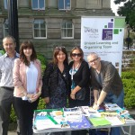 Sue (fourth from the left) and learning collegues at a recent learning stall in the town square