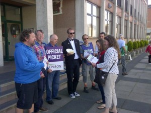 Carlisle City Councillors refuse to cross picket line.  UNISON member John Chambers is dressed as a Bullingdon Club member, handing out peanuts to public sector workers.