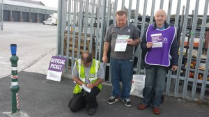 Striking Wyre Council street cleansing workers who were among the first pickets to turn out in support of the local.government strike at 5am today.  Wyre UNISON branch chair Arnie Dickinson (far right) and member Steve Oxley are pictured signing up.a new member on the line.