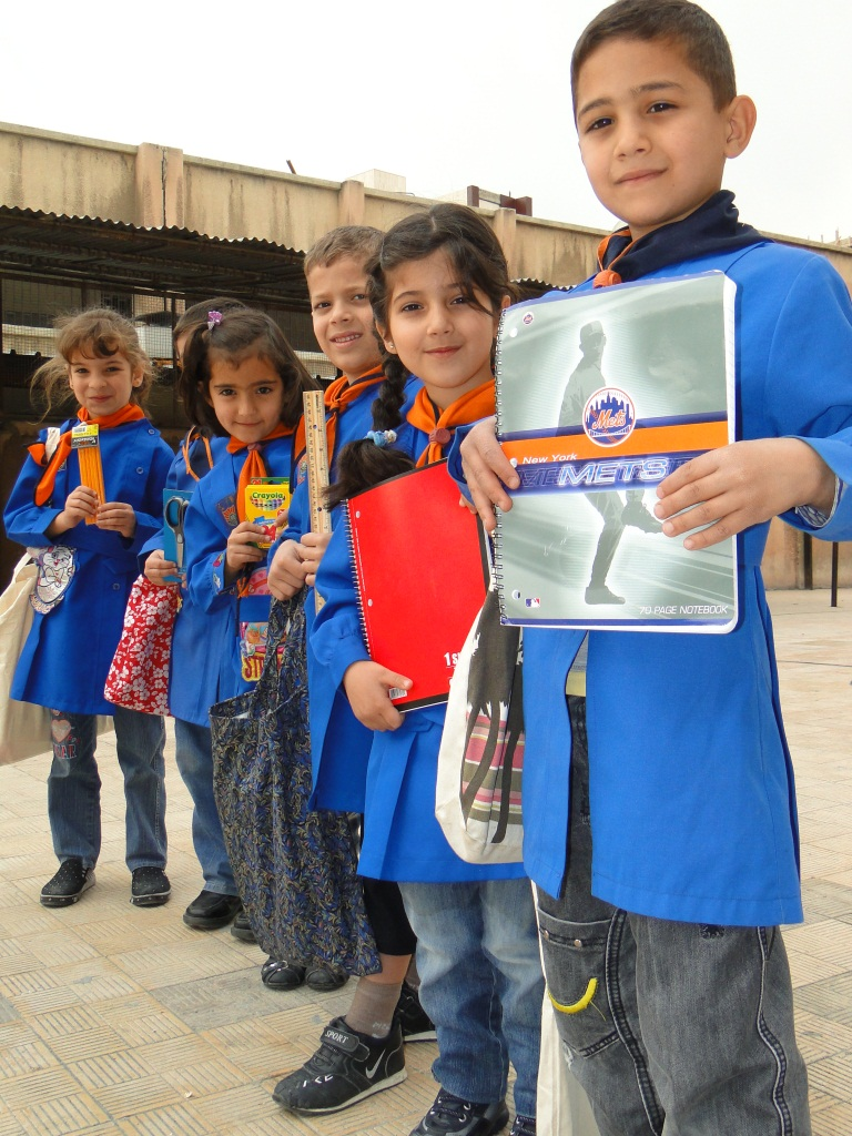 Iraqi refugee children with their new CWS School Kits.  IOCC/GOPA photo.