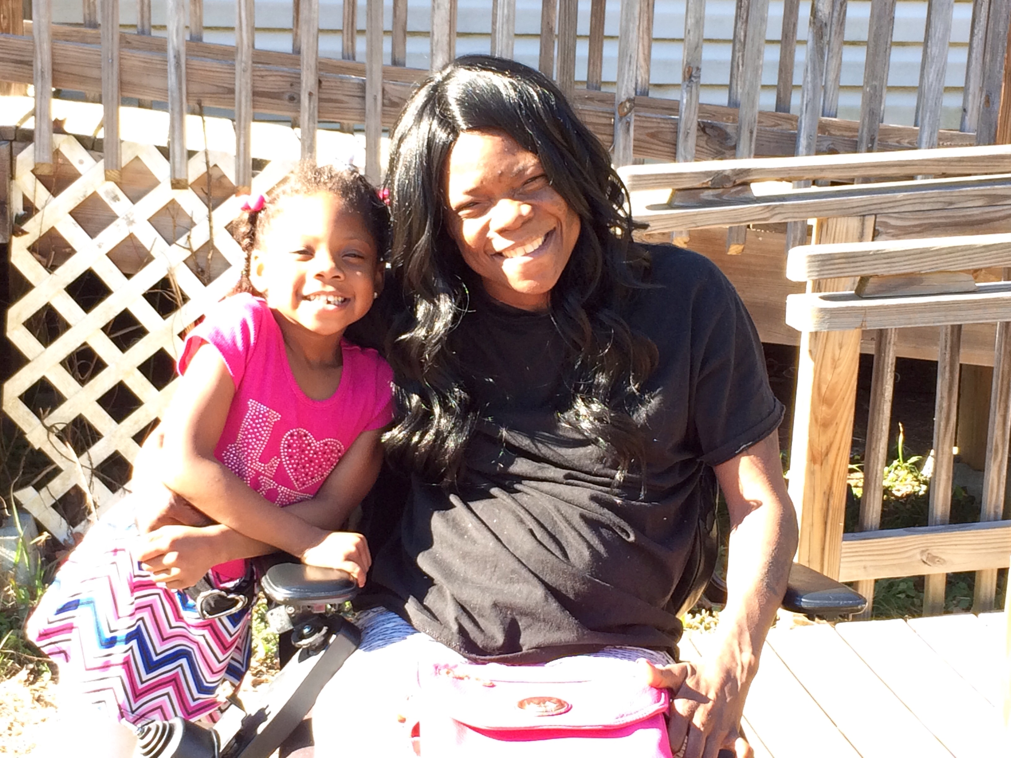Richshanda G. and her daughter Mylon outside their home in Columbia, S.C.