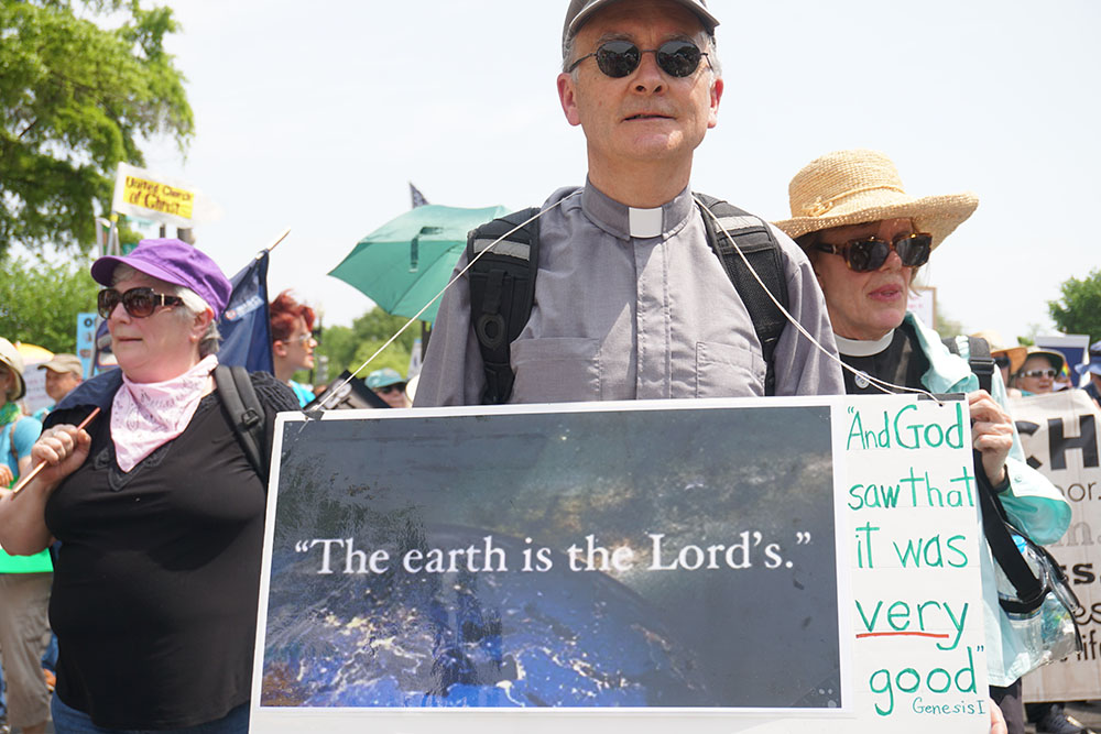 Peoples_Climate_March-Earth_is_Lords.jpg