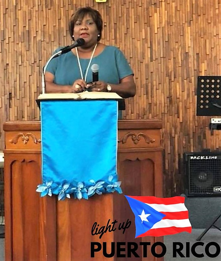 Tita in pulpit in Santurce, San Juan, P.R.