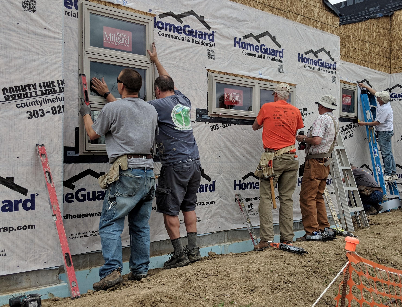 UCC Longmont Micah Homes window volunteers 2019