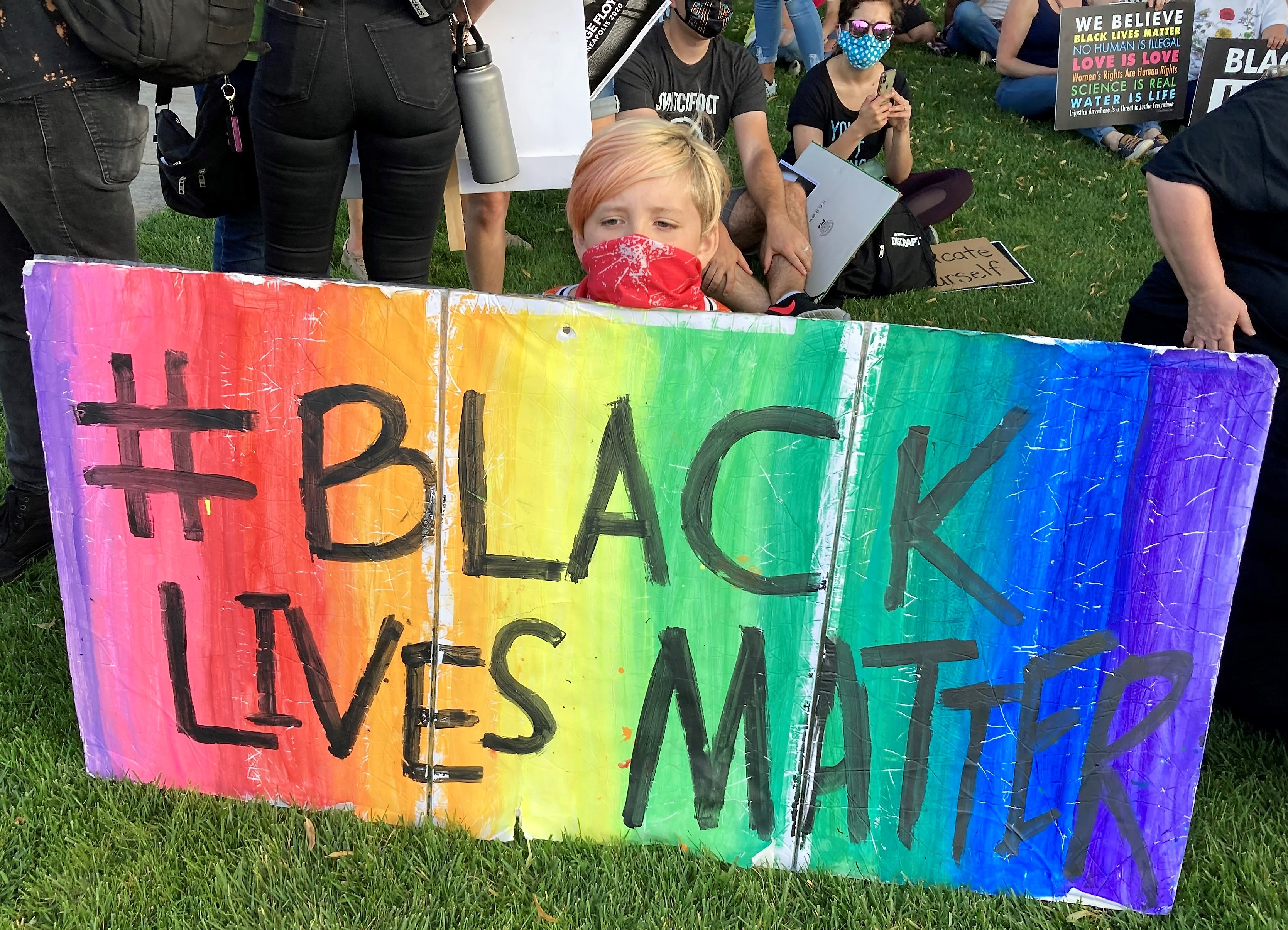 Young person from Milwaukie UCC with Black Lives Matter sign, 8/28/20