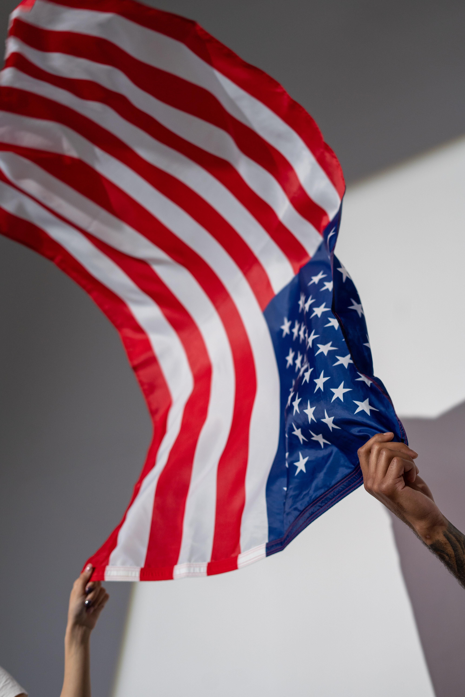 hands-holding-an-american-flag-4667369.jpg