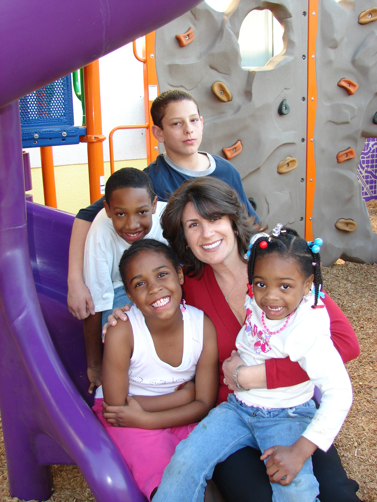 Stephanie_with_Children_on_Slide.jpg