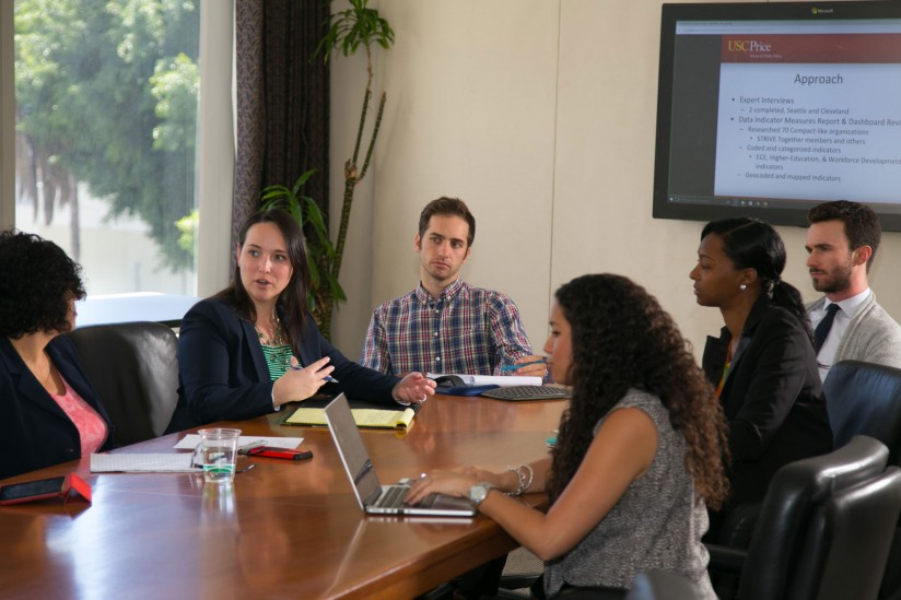 USC MPP students Jeanette Borden, Avery Seretan, Shinquell Green and Christopher Records present research project findings to the L.A. Compact Data Workgroup. (Photo/Tom Queally)