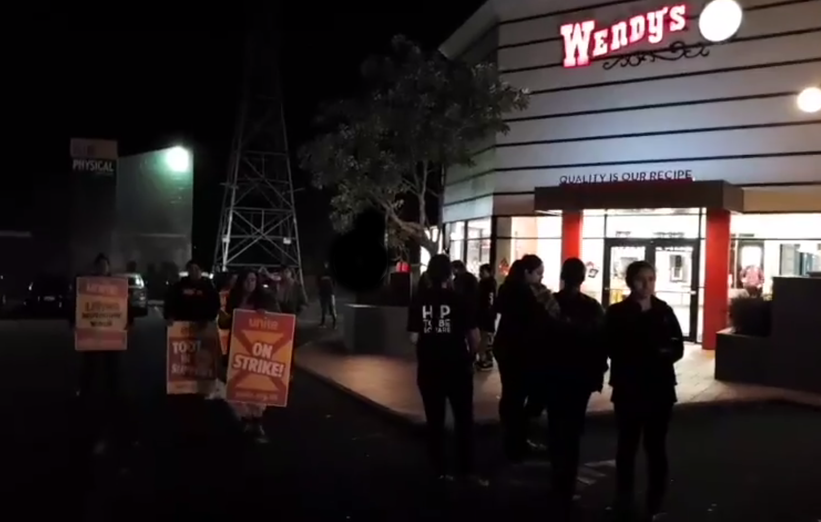 [Photo: workers walk out of work at Wendy's Te Atatu restaurant]