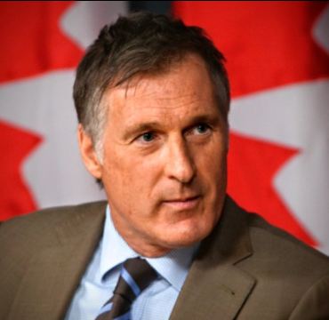 Maxime Bernier - Canada Flags In Background