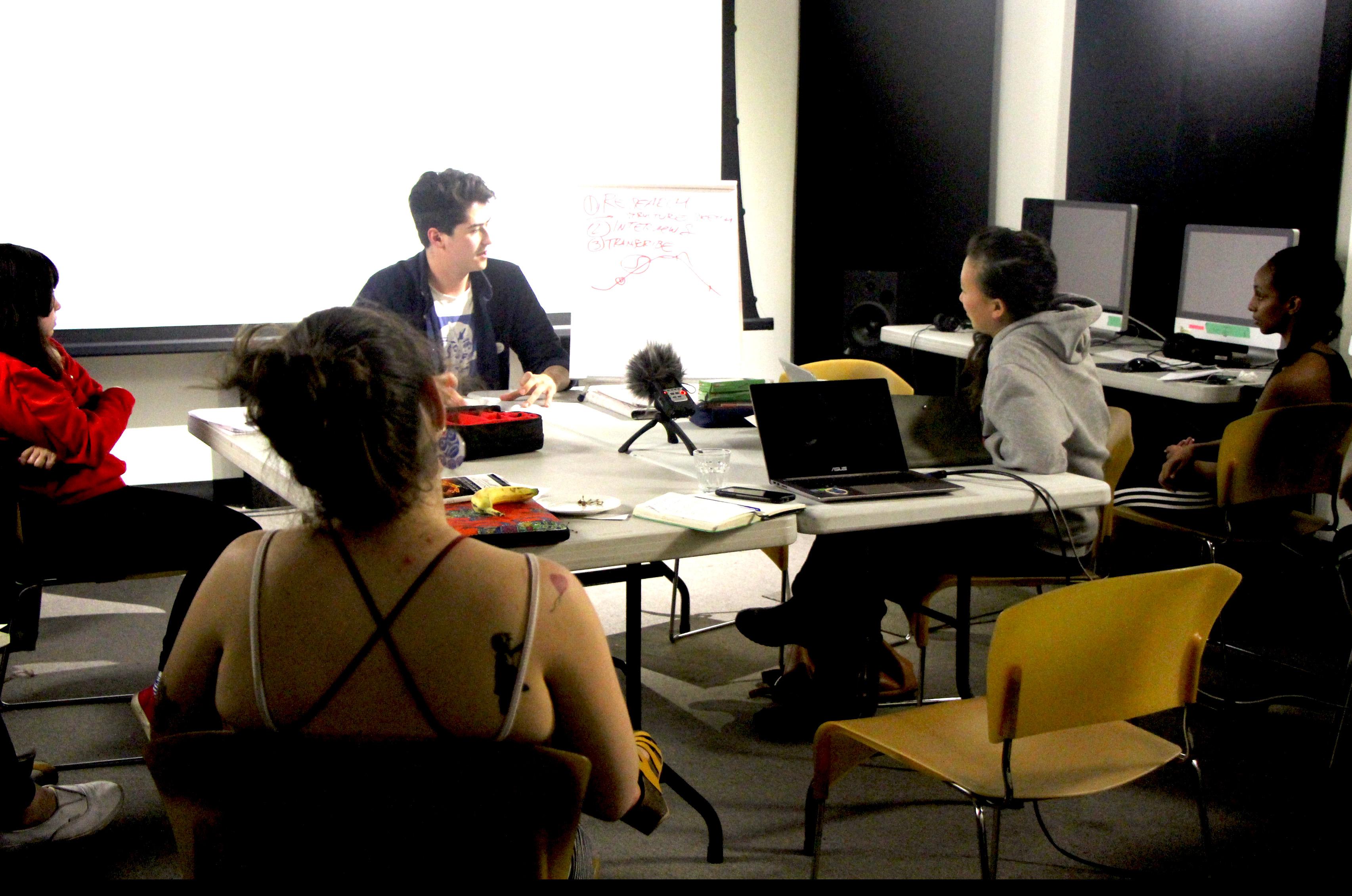 Alexander Kim presents to a circle of participants