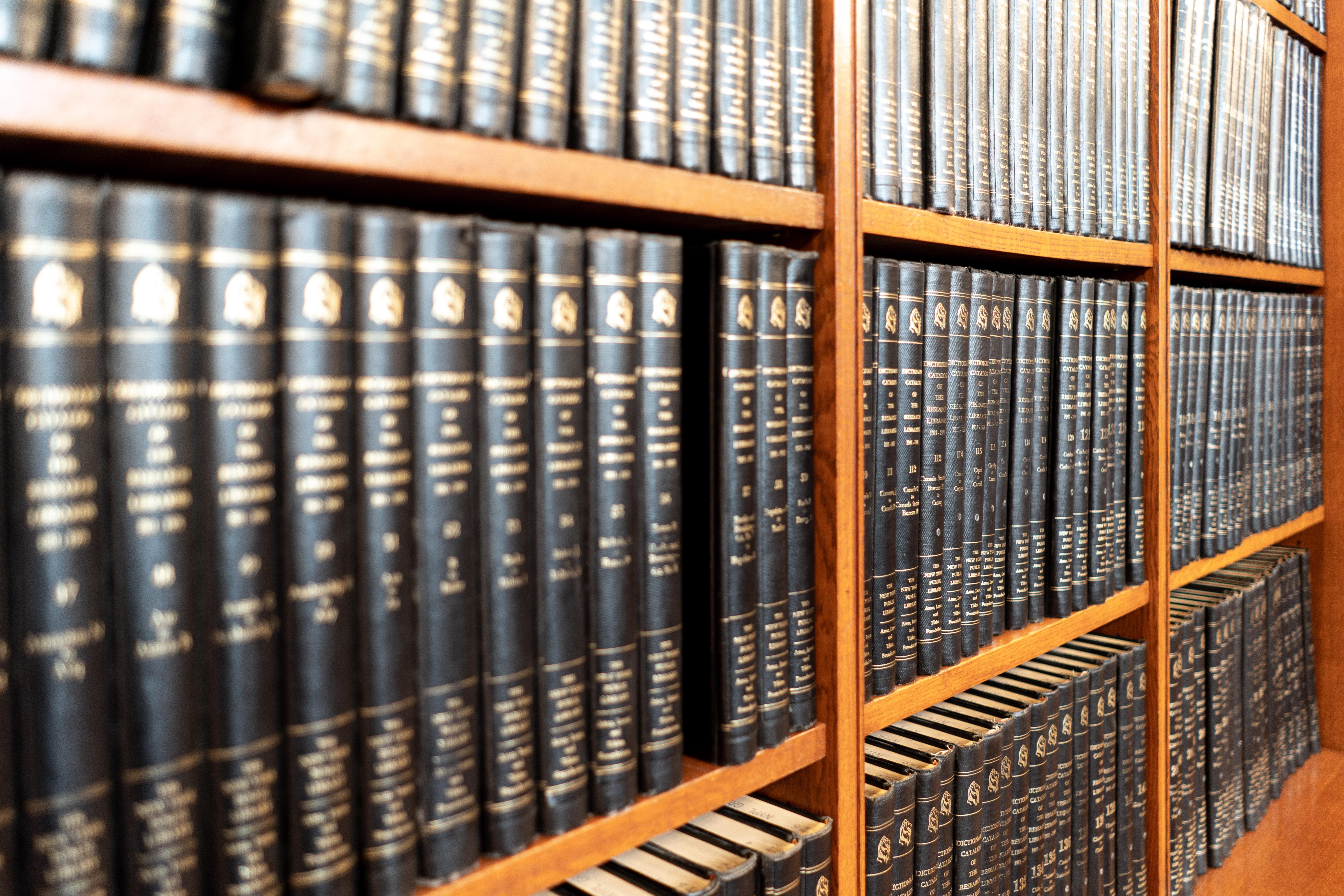 shelves of books on library shelf