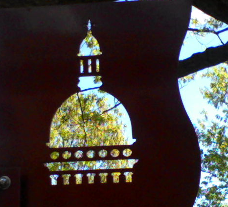 silhouette of New Jersey state house cut out of sign on state house property