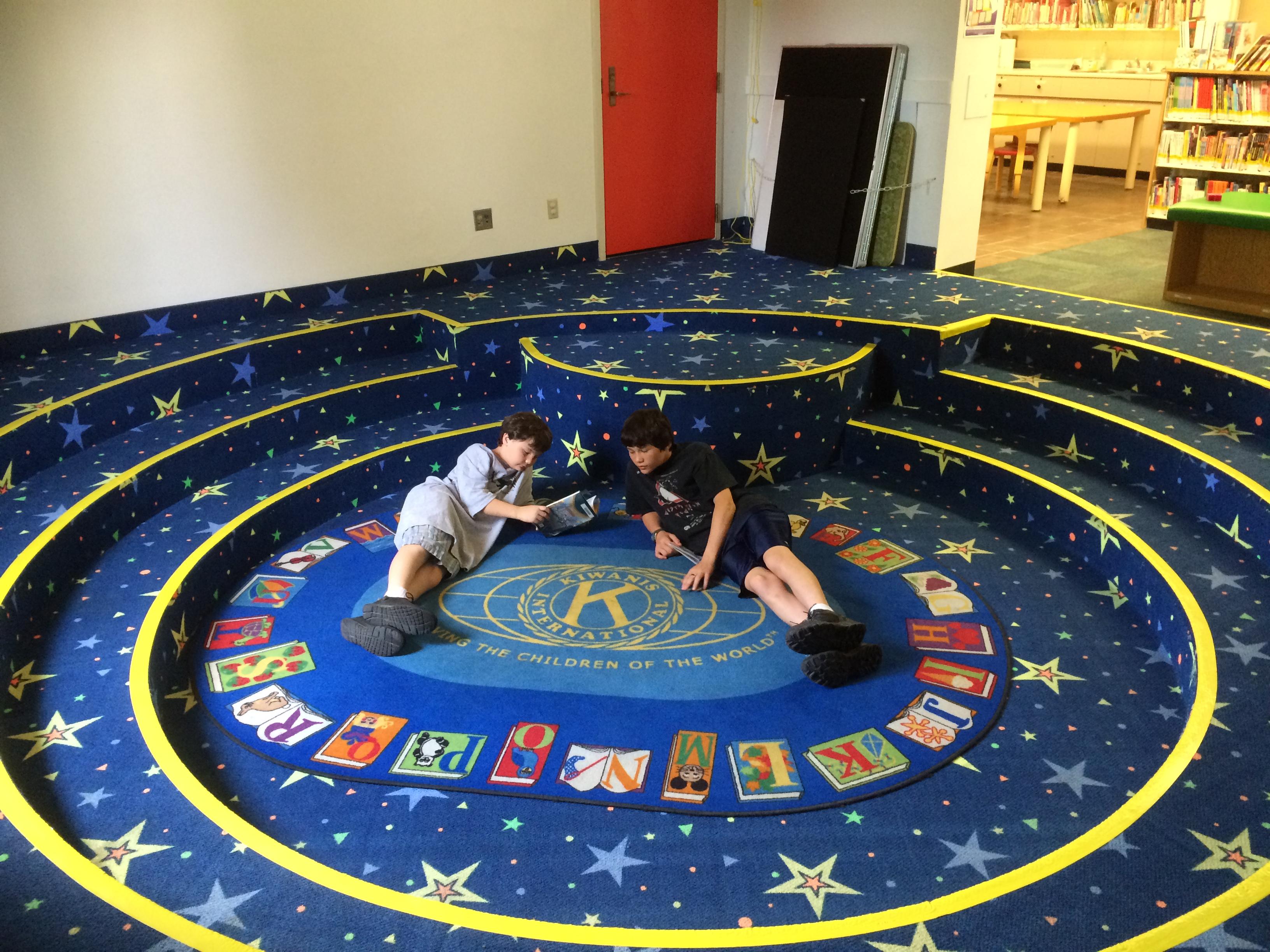 Niagara_Falls_Library_Kiwanis_Rug_with_Kids.jpeg