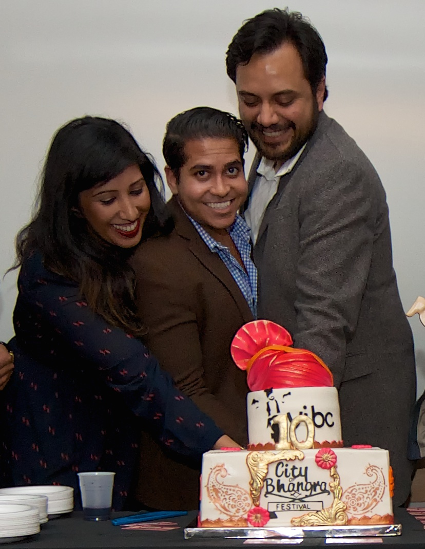 Blog__15_VIBC_2014_AGM_Mo_Dhaliwal__Vishal_Viralal__and_Kiran_Mander_cutting_cake._Joe_Carlson_photo.jpg