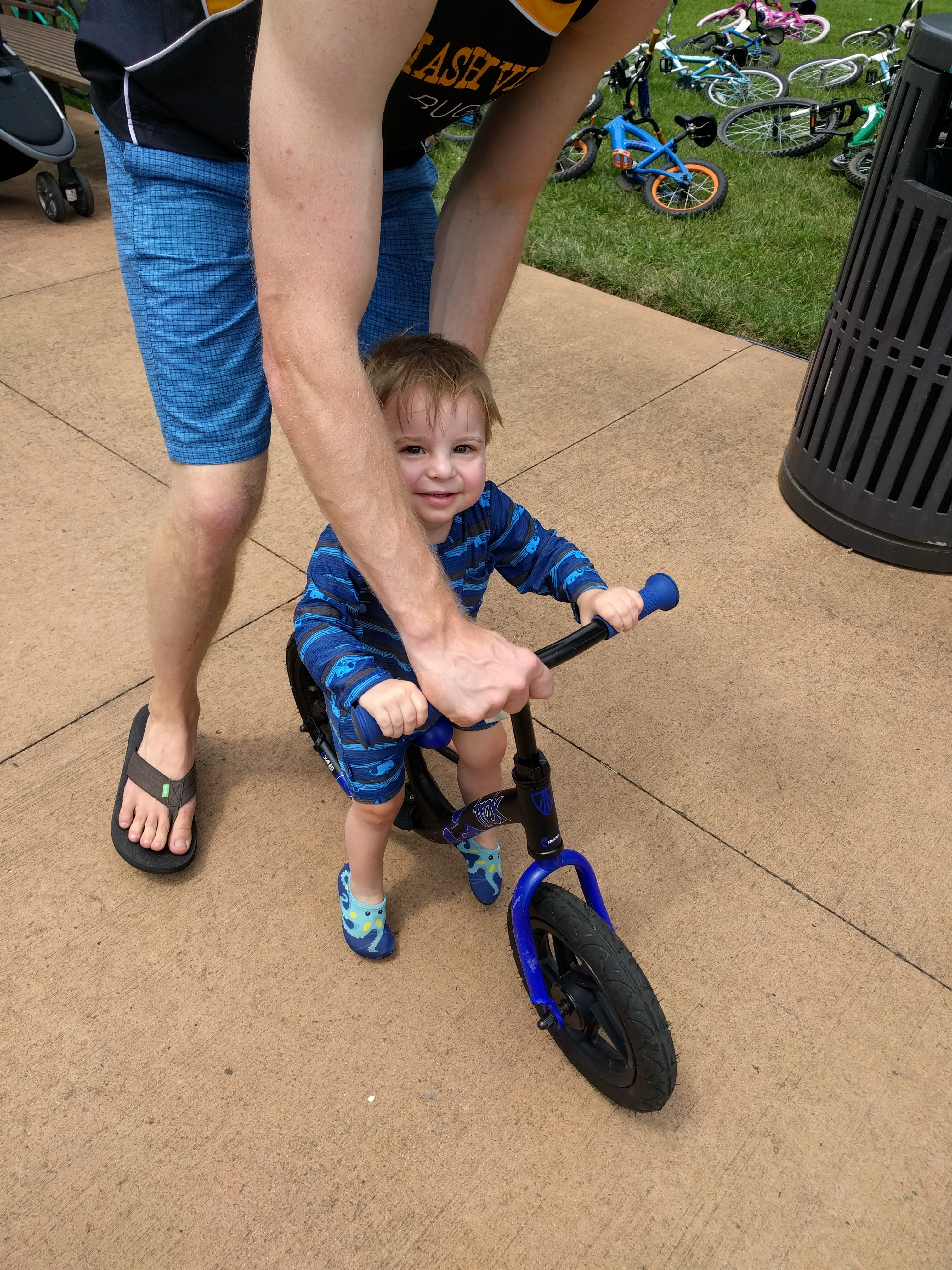 Dad teaches child to ride at WaterFest 2019