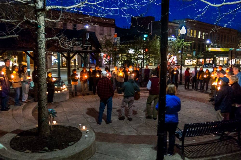 candlelight vigil participants in pliny park, brattleboro ,VT