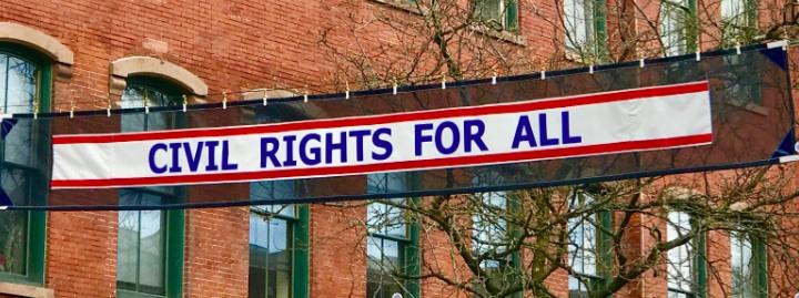 Cvil Rights for All Banner flying over Brattleboro, downtown.