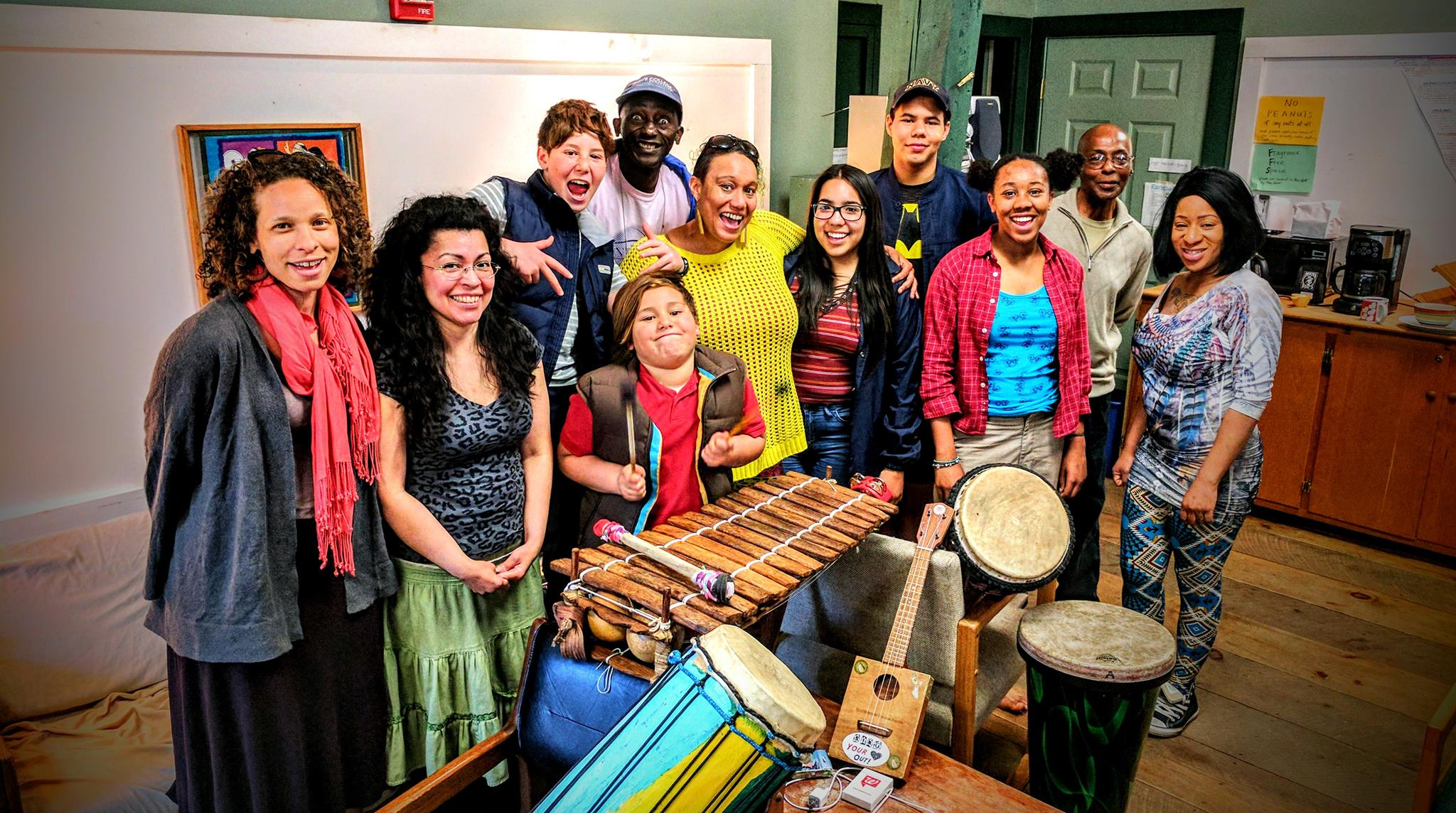 Group of participants gathered in front of a xylophone